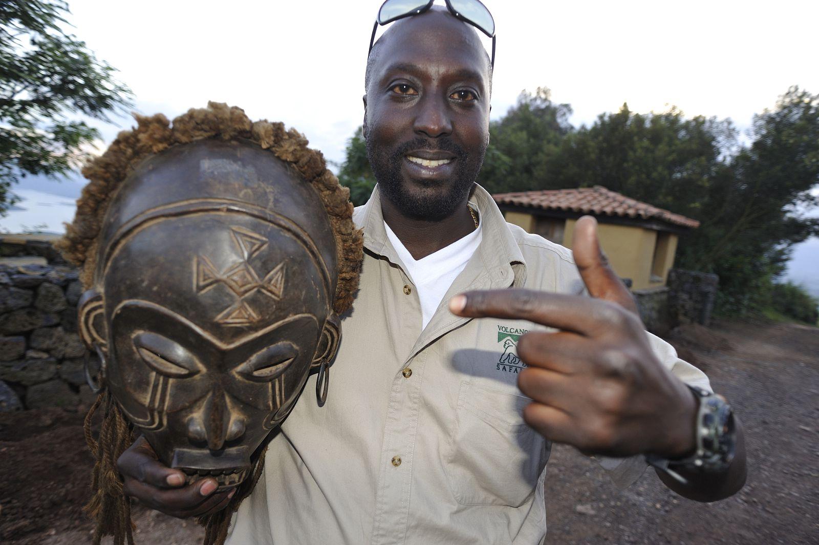 Amon Holding an African sculpture.
