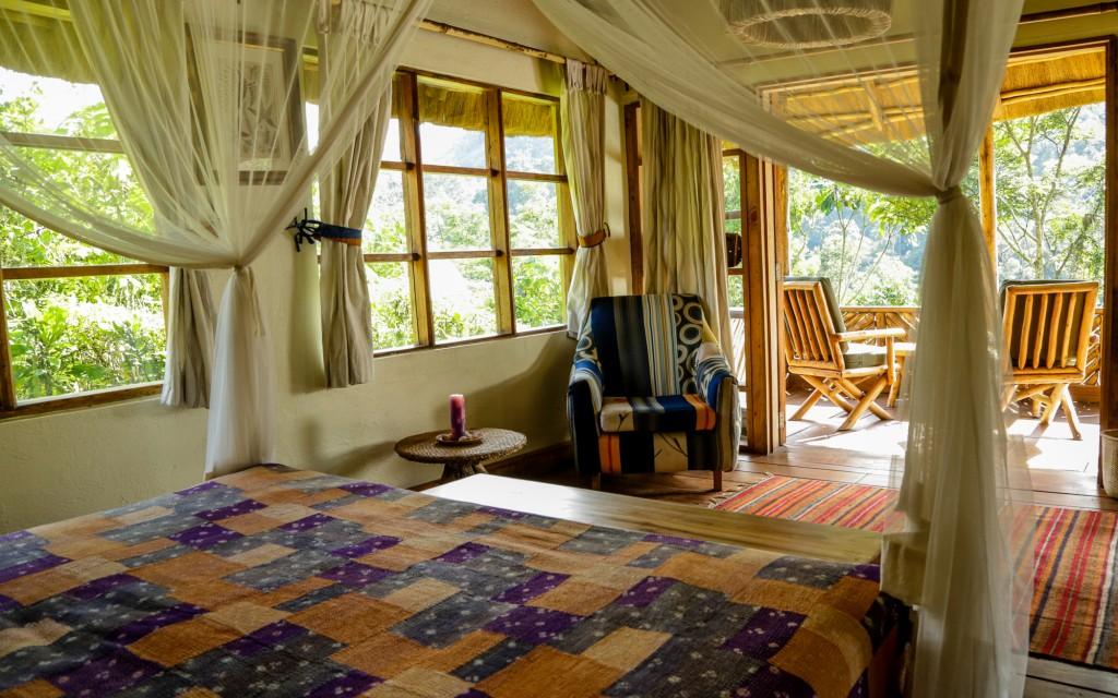 Bwindi Lodge banda bedroom interior and veranda