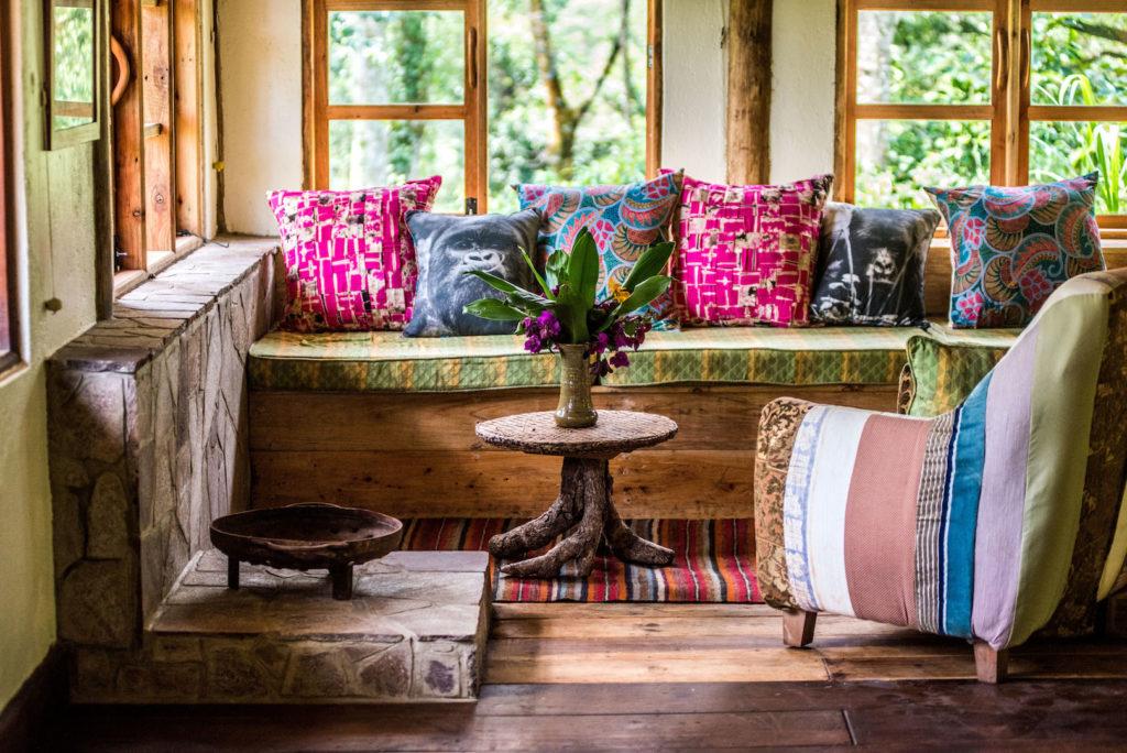 Bwindi Lodge new deluxe banda fireplace and sitting area